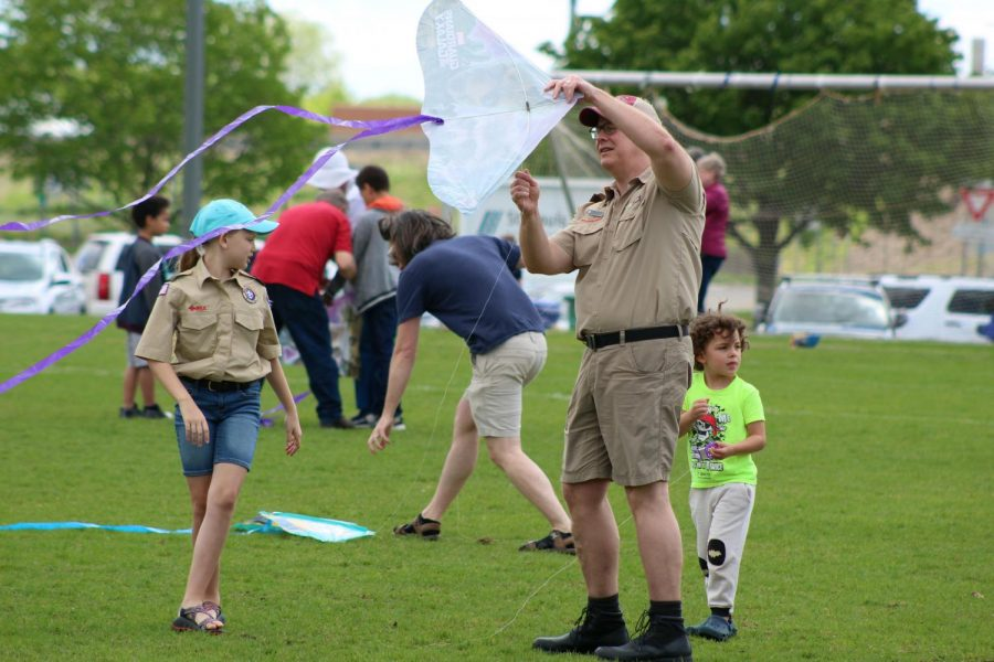 A member of Boy Scout Troop #738 helps untangle a kite. The 31st annual Kiwanis kite fly was held on Saturday May 25th at Louisiana Oaks park