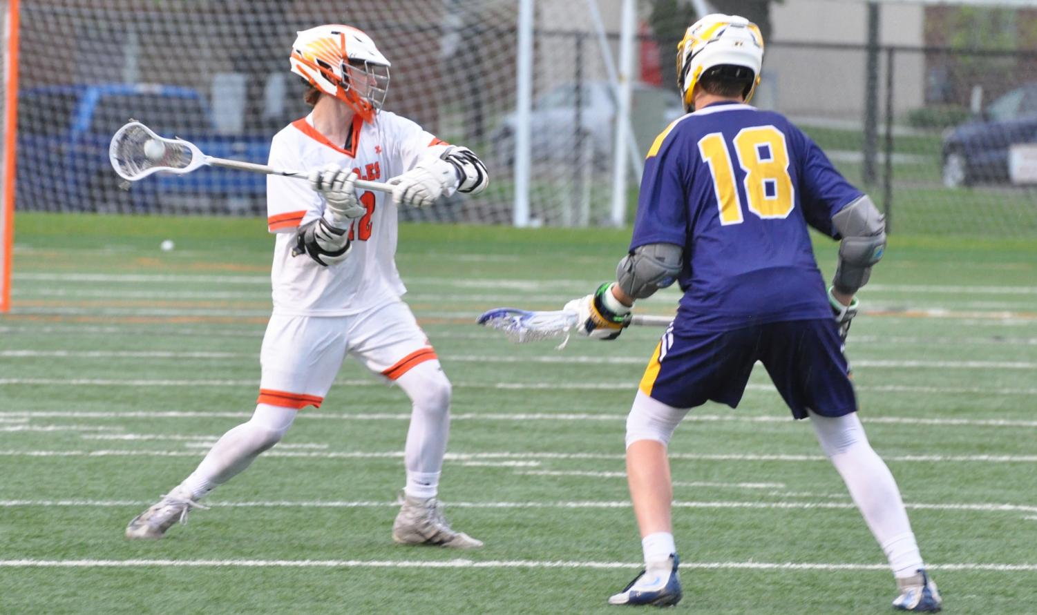 Junior Parker Brynildson avoids Kennedy's senior Andy Trenary and looks to move the ball upfield. Despite losing, Park forced Kennedy to use multiple timeouts throughout the game.