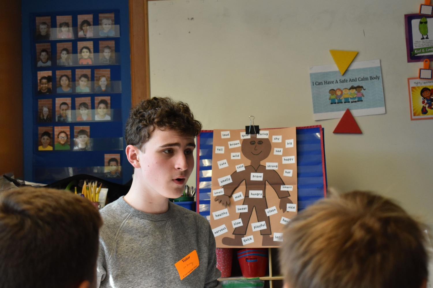 Sophomore Leo Dworsky models the notes in one of many songs he is teaching to fourth and fifth grade theater kids at Aquila Elementary School, May 9. The students will perform a showcase for parents and community members June 5.