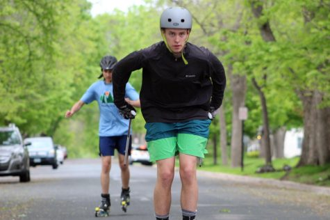 Sophomore Danny Walsh and junior Rakesh Plantz roller ski down the street May 21. They practice in preparation for a summer skiing program at Minneapolis Ski Club. According to Plantz and Walsh, they plan on participating in Nordic captains practices, Cross Country captains practices and Minneapolis Ski Club throughout every week.