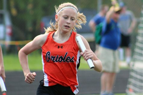 Freshman Olivia Brown runs in the four by four during the Sections 6AA meet. Athletes who made it in the top two of their event are going to State meet June. 8.