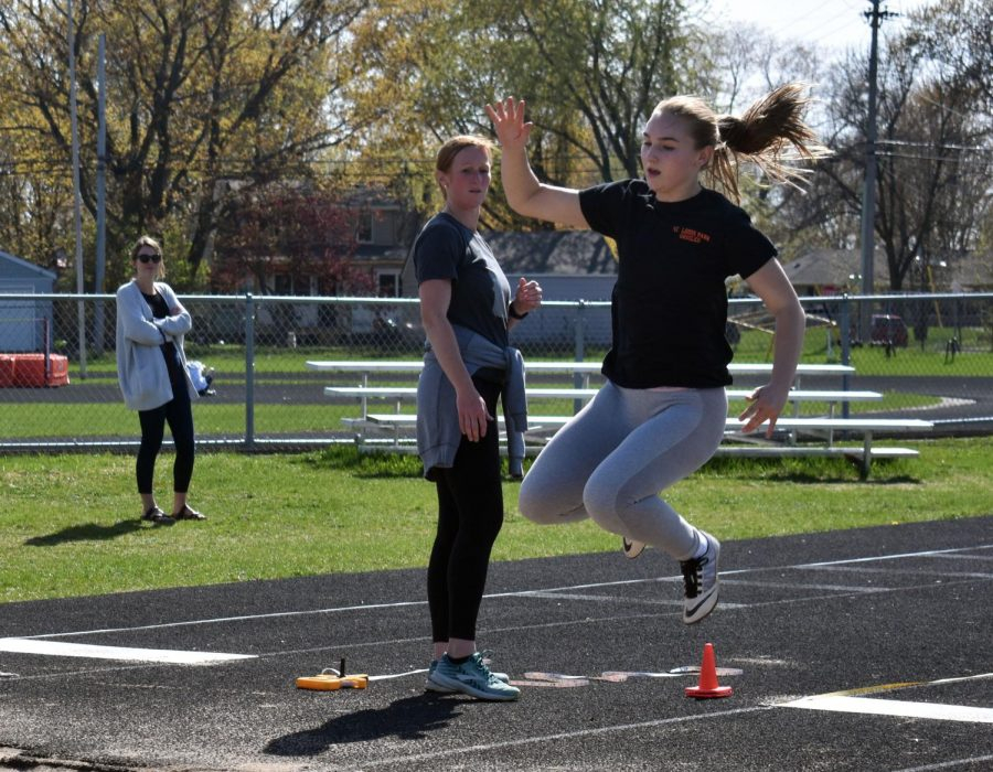 Senior Daisy Widboom works on her long jump technique during practice May 7. Long jumpers are only able to practice a few jumps a day because of the stress it puts on their muscles and joints according to Widboom.