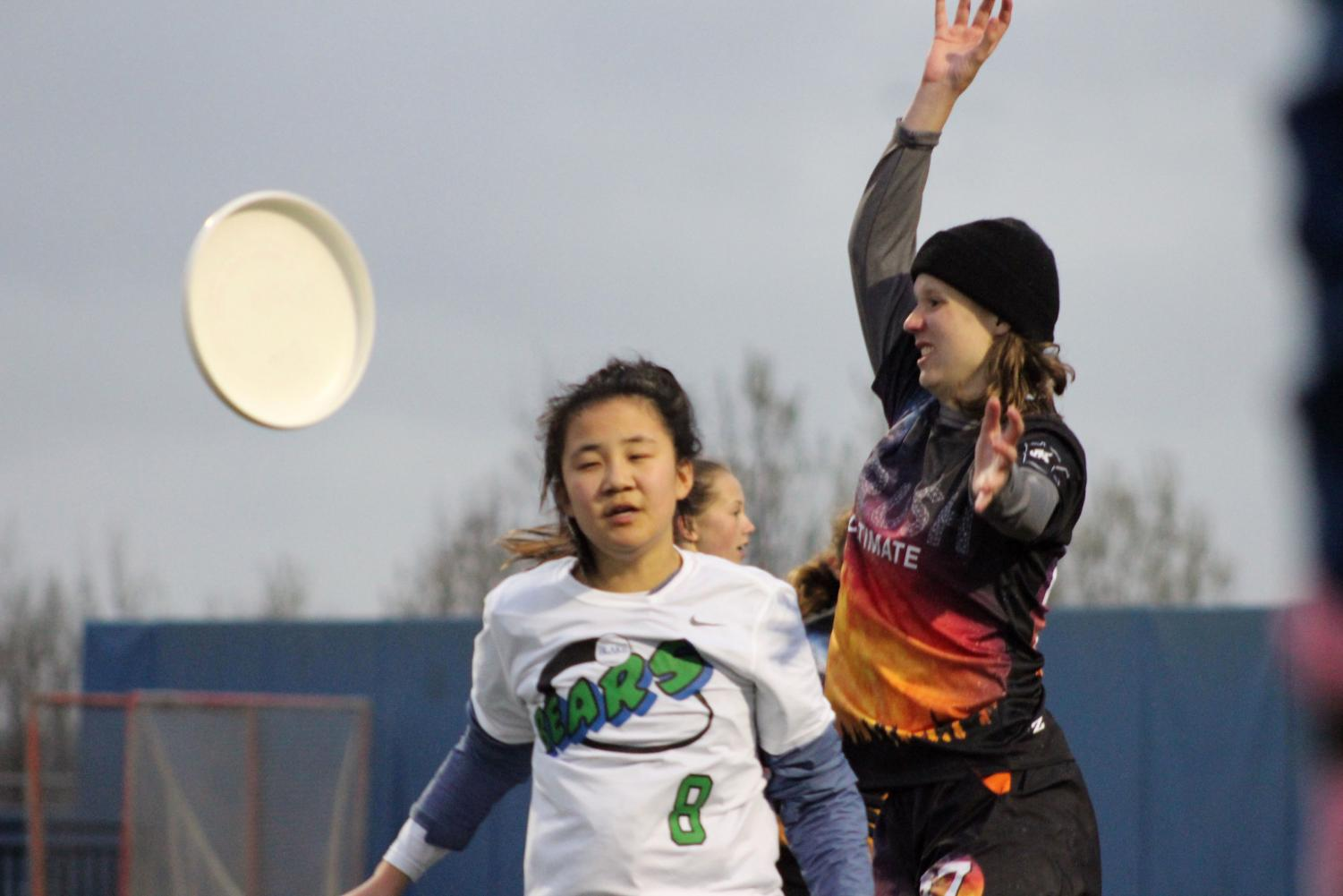 Junior Svea Bleske jumps to block a Blake player from catching the disc. Girls' Crush ultimate won the game against Blake 9-8 April 30.