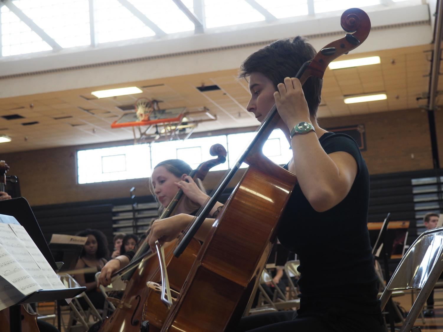 Senior Greta Long plays the cello in a cello quintet at the last Orchestra concert of the year June 3.