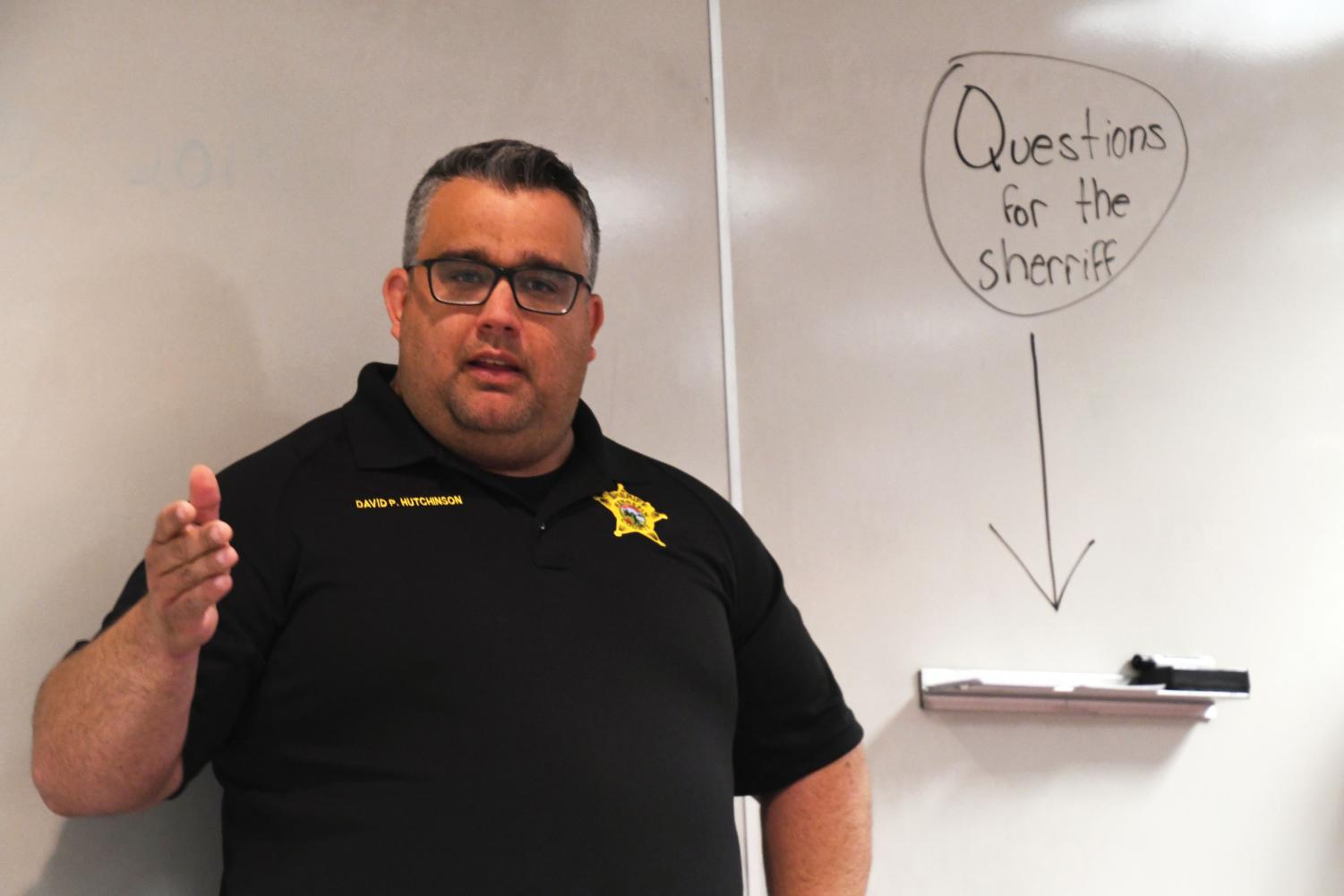 Hennepin County Sheriff David Hutchinson speaks to a small group of seniors in C350 June 3. Senior Cailey Hansen-Mahoney organized the event and allowed students to submit questions that they wanted Sherrif Hutchinson to answer.