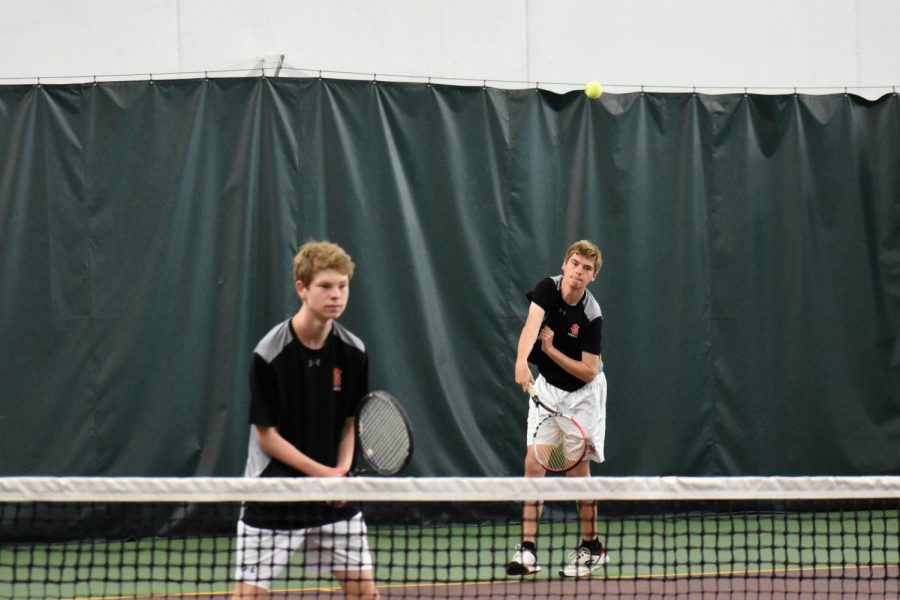 Doubles partners Cory Kleve and Clayton Horseman use teamwork to win the match in sections. Section were on May 23.