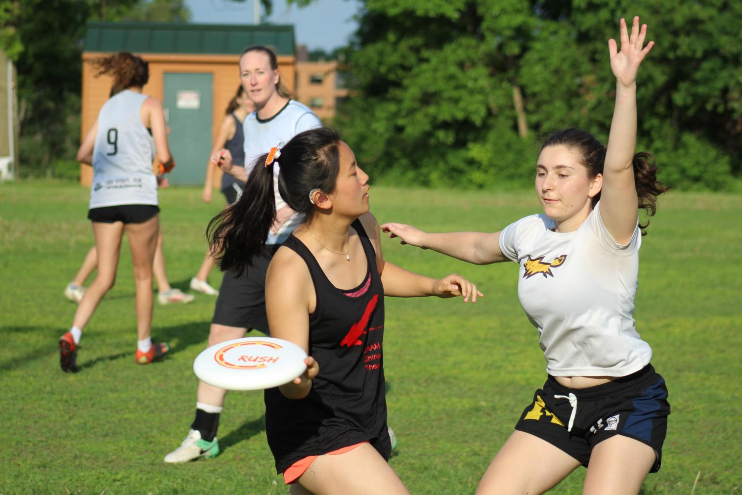 Senior Anna Kasper flicks the disc to her teammate June 5 at Oak Hill Park. The Park ultimate boys' and girls' teams played the coaches and alum during this end of the year team bonding game.