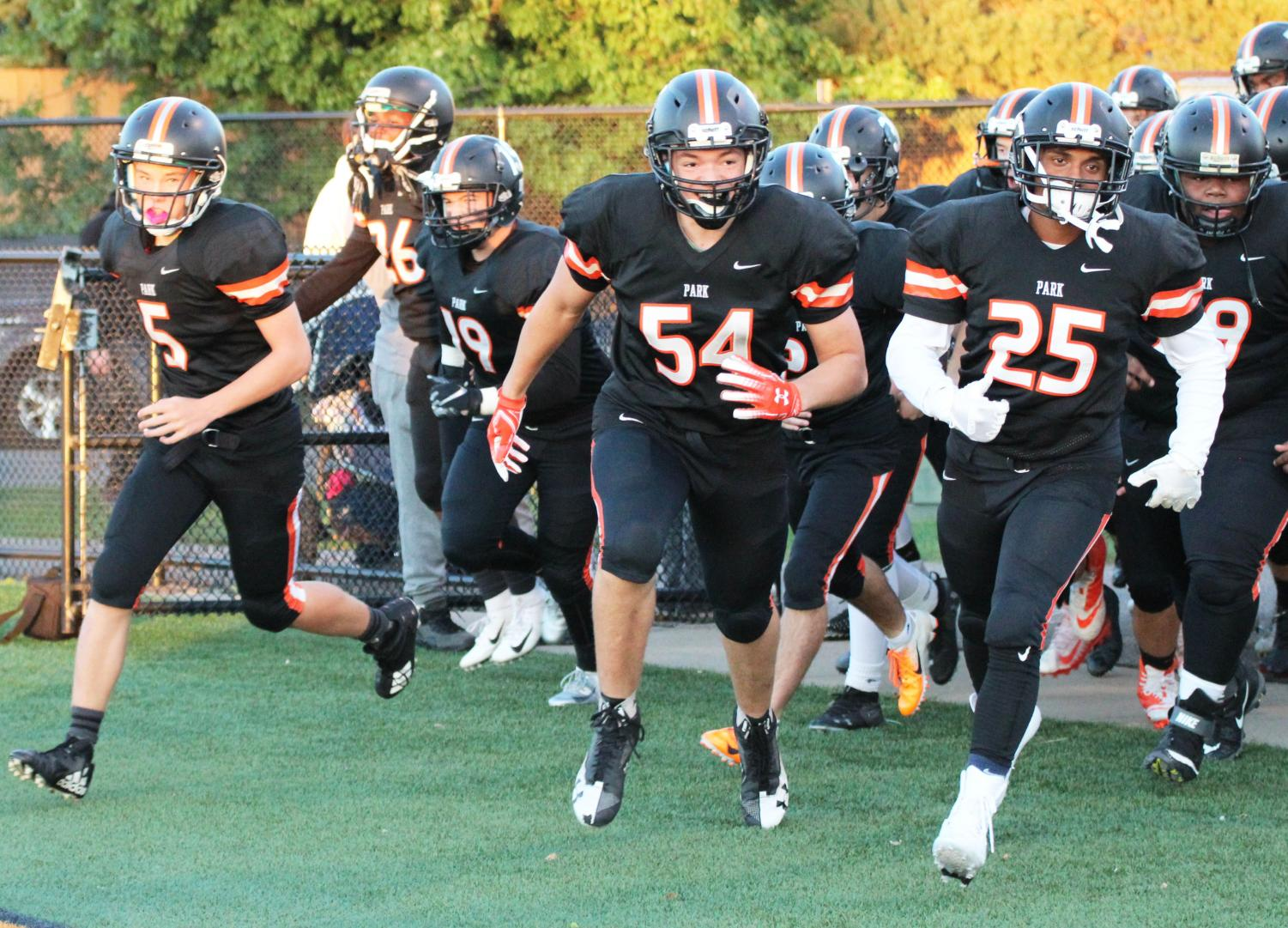 The football team runs onto field in their first home game of the 2018 season. The  first home game of the 2019 season will be Aug. 29 at the Oriole Stadium.