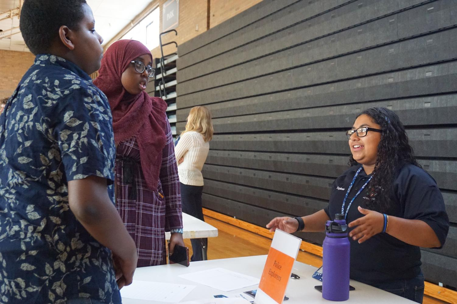 Junior+Isela+Perez-Kauhaihao+talks+with+incoming+freshmen+about+her+experience+on+the+Police+Explorers.+This+program+is+one+of+the+many+students+could+learn+about+during+the+activities+fair+Aug.+28.