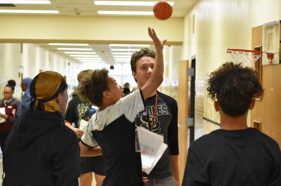 Math teacher Robert Otto plays basketball with a group of freshmen in the hallway during Freshman Orientation Aug. 28. Orientation was an opportunity for incoming students to meet with their teachers and prepare for the upcoming school year.