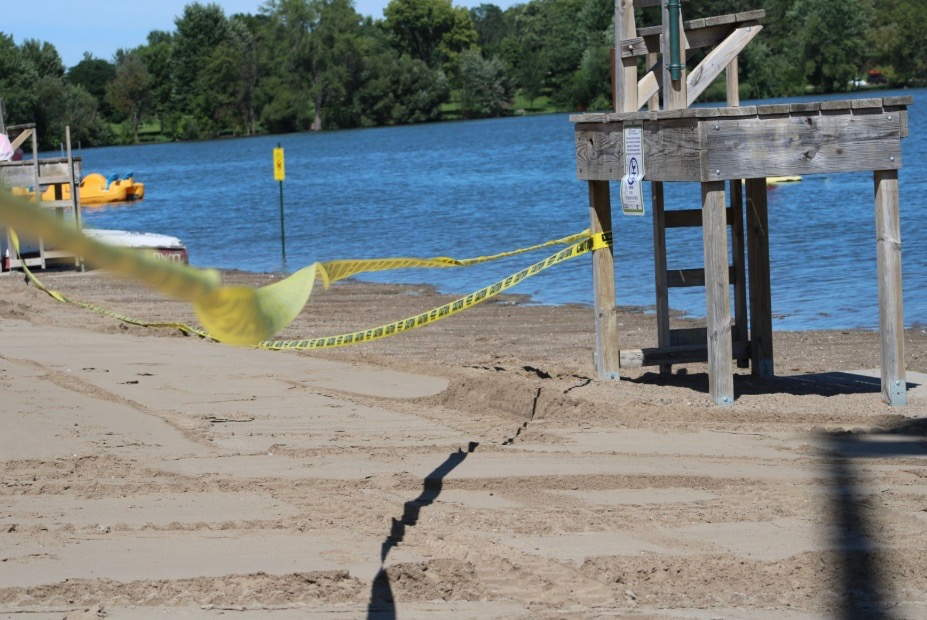 Yellow caution tape blocks swimming at Lake Nokomis due to positive E. Coli tests. According to the Minneapolis Park and Recreation Board, the beach on Lake Nokomis will not be open for the remainder of the year.