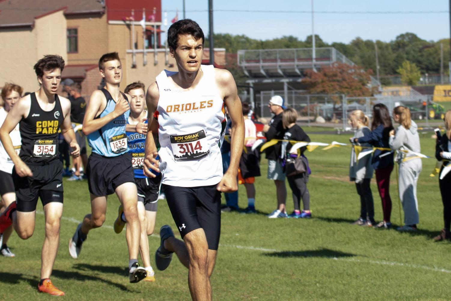 Senior David Klein dashes to the finish line of the Roy Griak Invitational Sept. 28. Klein finished the five kilometer race with a time of 19.40.4 which places him 294th of 561 competitors.