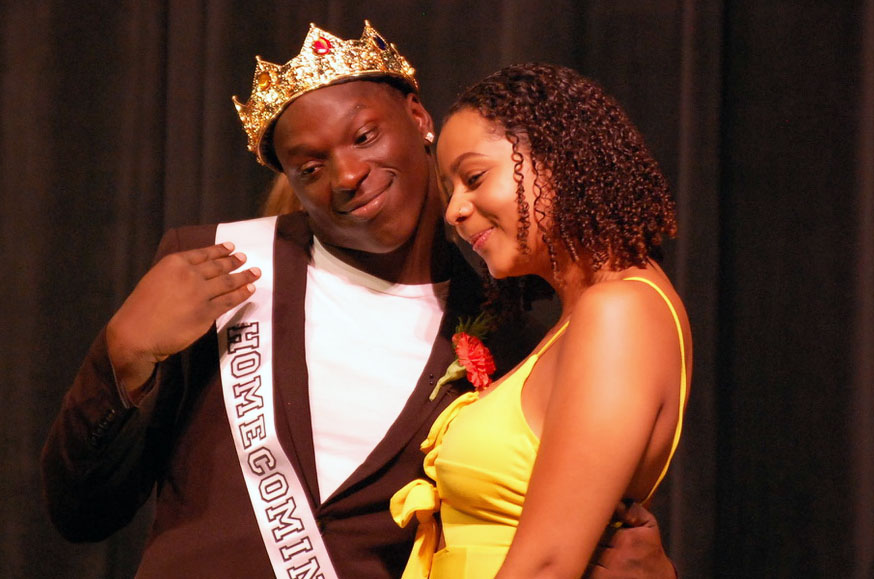 Seniors Tobyous Davenport and Alyscia Thomas pose for a photo after the ceremony. Davenport was voted Homecoming king.