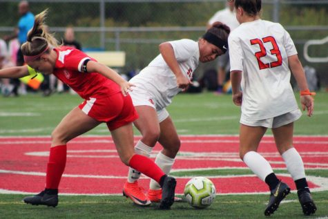 Senior Aliviah McClinton fights for the ball in the game against BSM. Due to the game the soccer teams record is now 5-3-2.