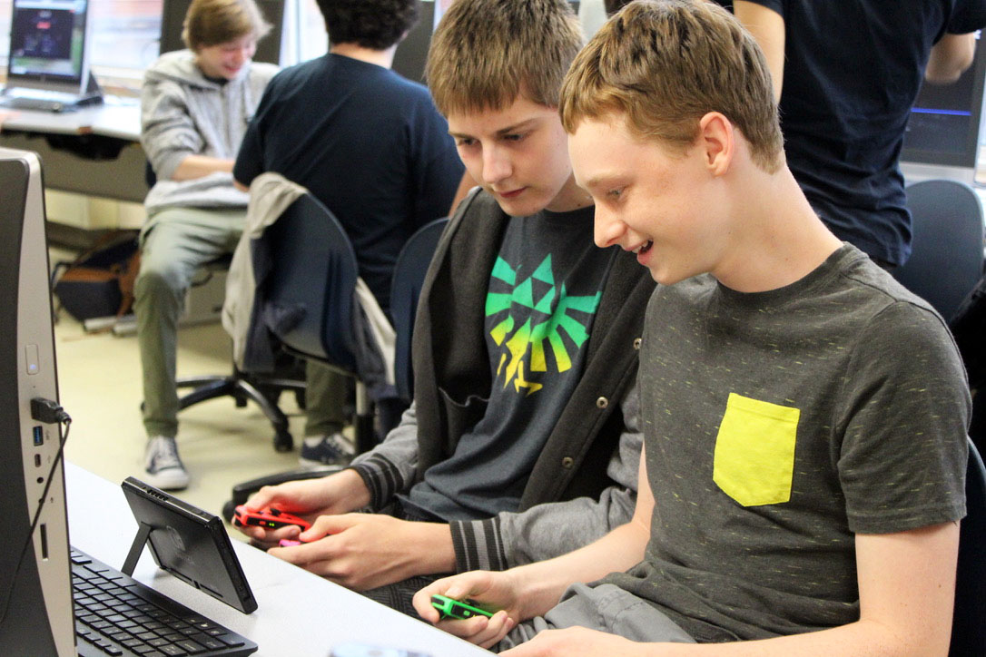Senior Joseph Lindstrom and sophomore Cole Blavat play a video game on the Nintendo Switch before the Esports meeting. The meeting was hosted to get the team members registered Sep. 12.