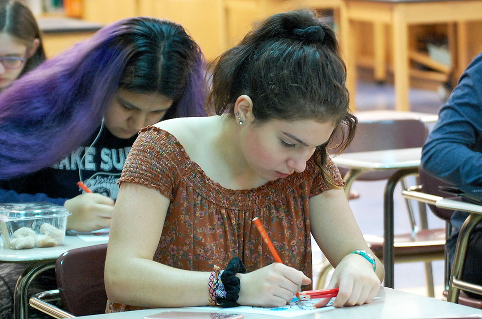 Freshman Amalia Fischer draws on a coloring sheet hand out during the first Intersectional Feminism Club meeting of the year. The club met Sept. 12 to collaborate on its goals for the year.