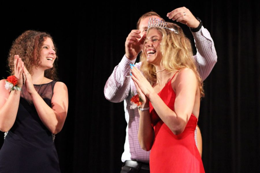 Senior Hattie Kugler is crowned Homecoming queen by Principal Scott Meyers. Kugler won against seniors Alyscia Thomas and Donae Ives.