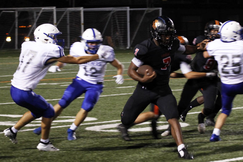 Senior, Sajid Nathim powers though opposing players helping park towards a touchdown. This was park 4th game of the season. Their next game will be Sep. 27.