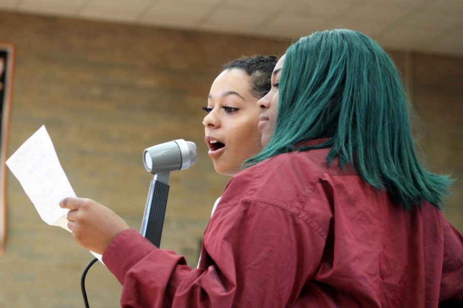 Seniors Alyscia Thomas and Aleah Schumann announce with names of students who have shown Park pride. Students were chosen by the administration and celebrated by the student body.
