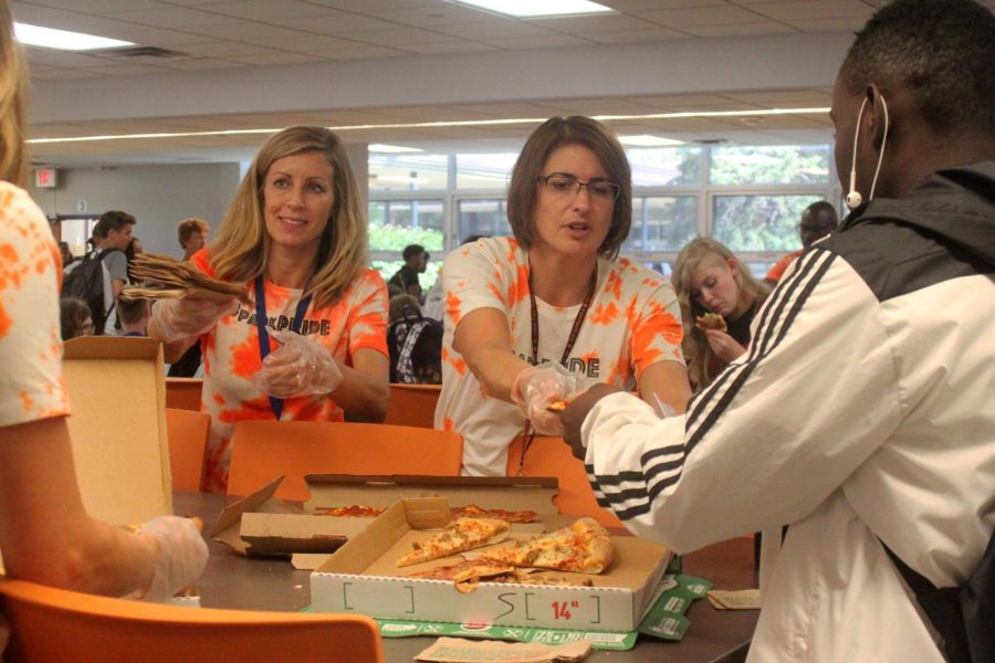 Counselor Kelly Brown and social worker Marlee Nirenstein serve pizza to students during lunch on the first day of school. Students enjoyed Papa Johns and Parkway pizza for free.