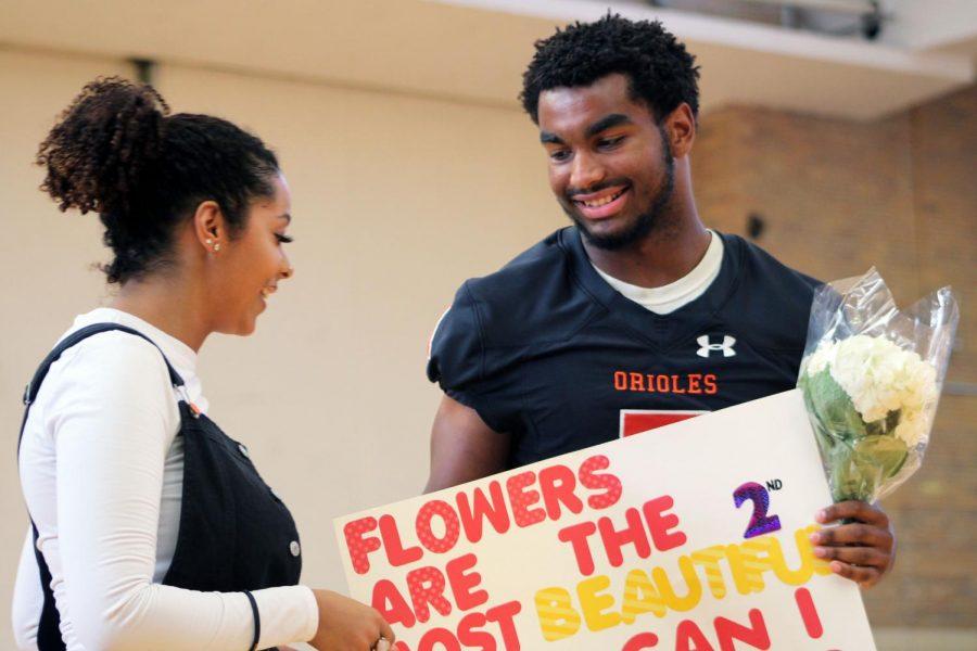 Senior Sajid Nathim asks senior Alyscia Thomas to accompany him to Homecoming. The Homecoming dance was held Sept. 21 at the high school.