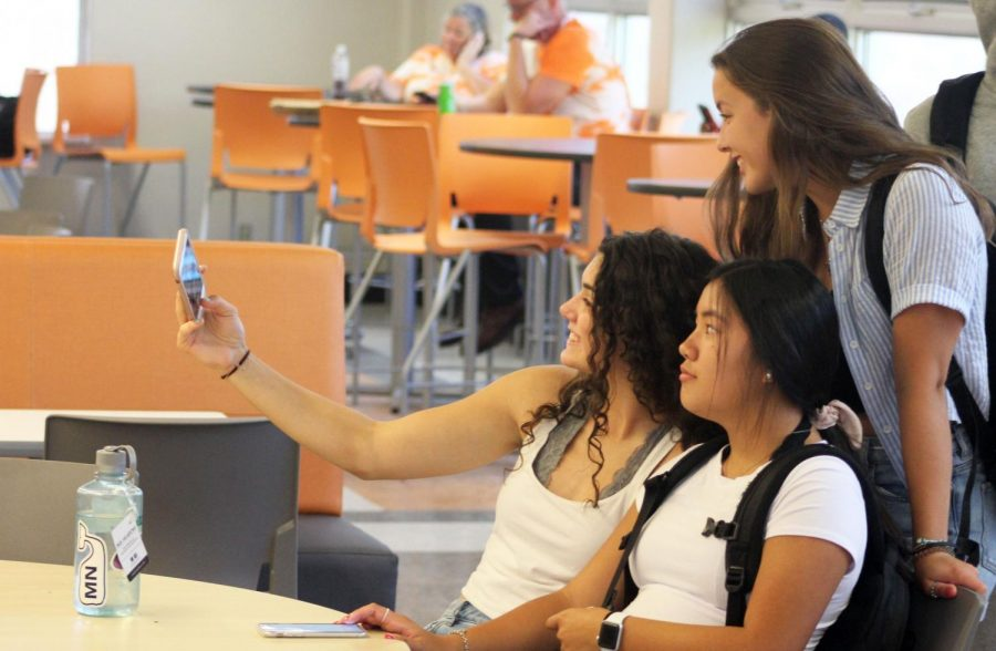 Juniors Marissa Boettcher, Hannah Howell and Selee Olmen take a selfie during lunch. First day activities allowed students to reconnect with each other after summer break.