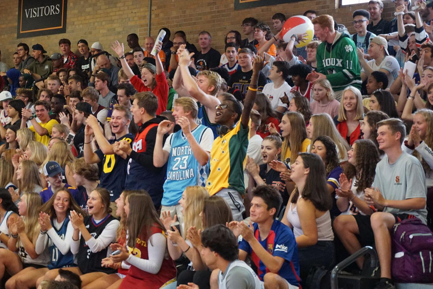 The+senior+class+stands+and+cheers+with+excitement+at+the+first+day+of+school+Pep+fest+Sept.+3.+The+class+wore+jerseys+to+show+their+senior+pride.