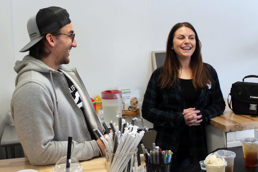 SLP Nutrition founders Alex Brose and Allyson Oman laugh as they wait for someone to order a drink. According to Oman, SLP Nutrition is a health club with a mission of creating a healthy community.