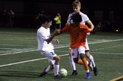 Senior Mohamed Mohamed dribbles the ball toward a Blake defender. Park won 1-0 against the Blake Bears.