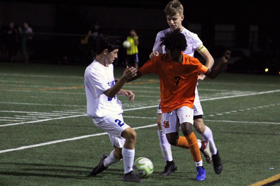 Senior Mohamed Mohamed dribbles the ball toward a Blake defender. Park won 1-0 against the Blake Bears.