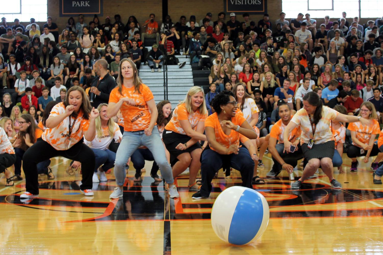 Teachers+dance+to+the+Cha-Cha+Slide+at+the+Pep+fest+Sept.+3.+The+show+was+put+on+for+incoming+freshmen+and+returning+students.