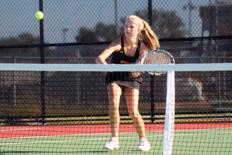 Freshman Kamryn Halley hits a volley during her match Sept. 23. Players are preparing for Sections beginning Oct. 2.