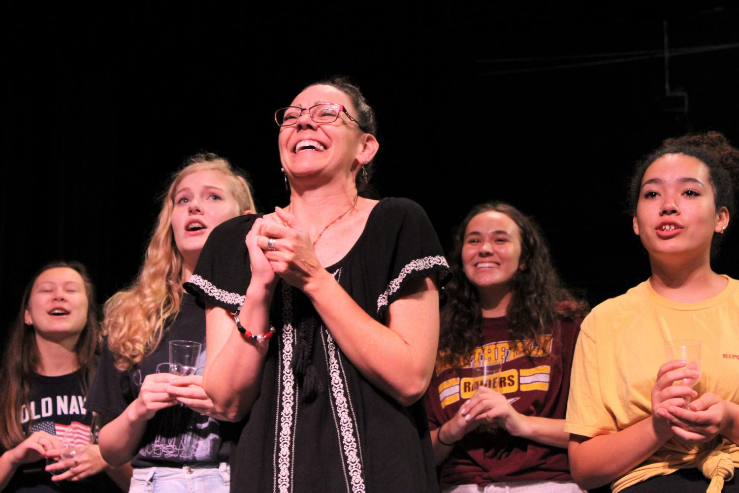 """Choreographer Julianne Mundale, junior Lilly Strathman, sophomore Dayanara Mora Zengel and freshmen Haley Nielson and Gwendolyn Rockler-Gladen rehearse the opening number of """"Legally Blonde"""". The show will open 7 p.m., Nov. 15 in the Auditorium."""