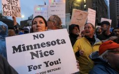 Protesters from anti-Trump rally express unwelcoming feelings towards President Trump's visit to Minneapolis.