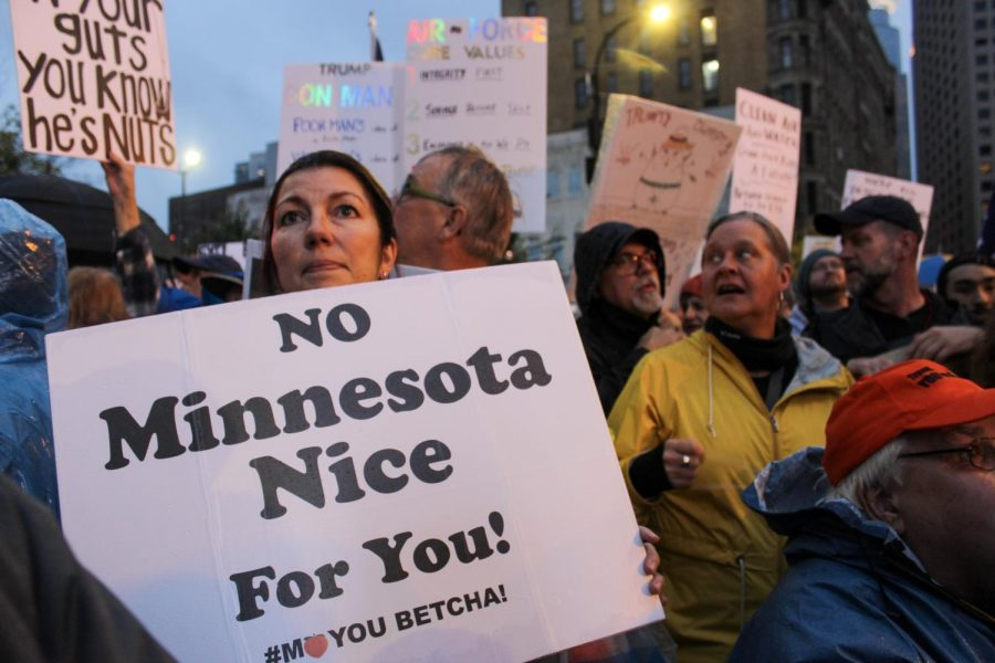 Protesters+from+anti-Trump+rally+express+unwelcoming+feelings+towards+President+Trump%27s+visit+to+Minneapolis.