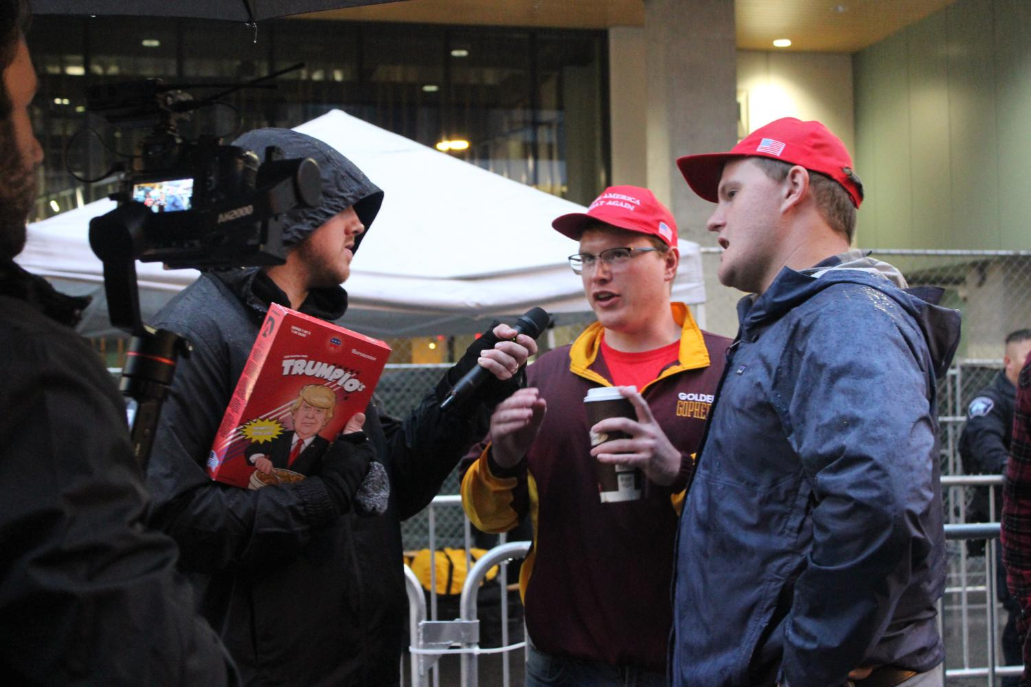 Two Trump supporters get interviewed prior to entering Trumps campaign in Minneapolis starting at 7 p.m Oct. 10.
