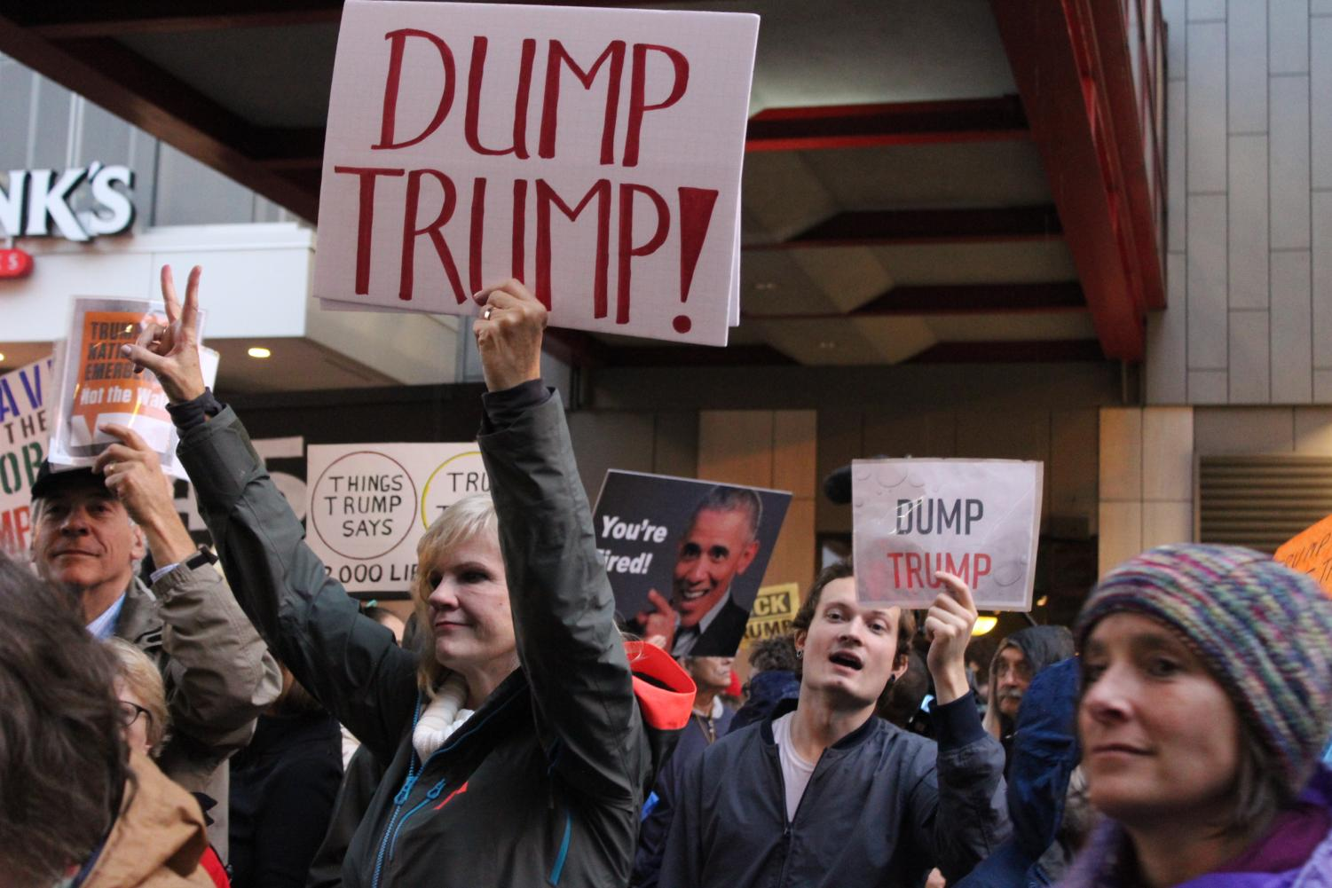 Protesters rally against President Trump outside the Target Center Oct. 10. Minnesotans chanted and held up signs throughout Trump's campaign.