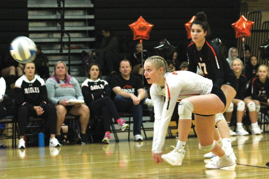 Senior+Addie+Warg+dives+for+the+ball+during+the+game+against+Chanhassen+Oct.+3.+Girls%27+volleyball+won+3-0+on+senior+night.