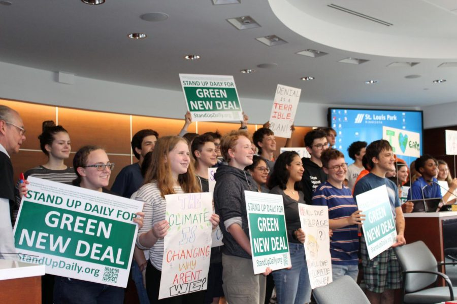 Park students pose for a picture Sept. 27 at St. Louis Park City Hall. Young activists gathered to express support against climate change.