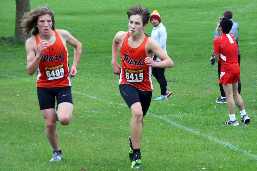 Sophomore Henry Nelson runs in the Metro West conference championships. Nelson finished the 5 kilometer race with a time of 19:16.
