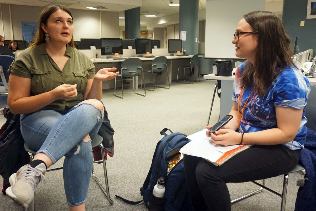 Junior Liz Hodges practices while debate coach Samantha Leo times her. The debate team is currently preparing for an important upcoming tournament Nov. 8-9 at Apple Valley High School.