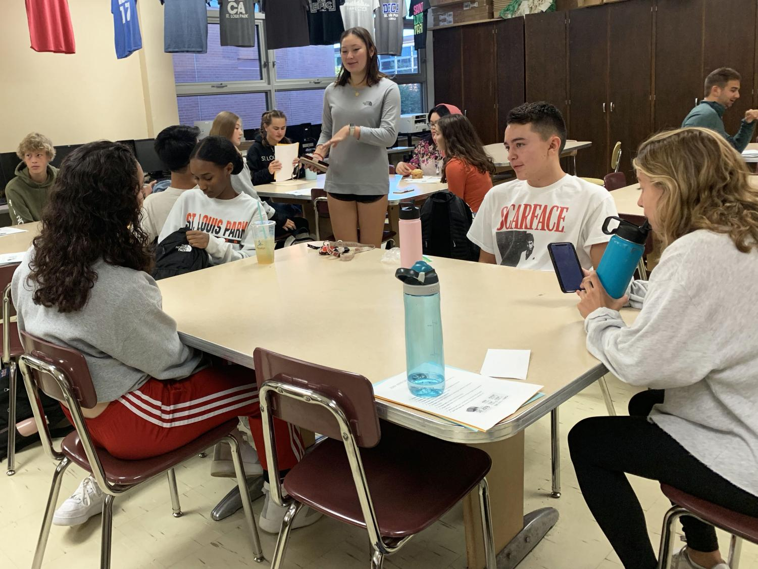 Junior Emma Amon leading group activity for a mock interview. This is the first informational meeting regarding DECA's fundraising and field trips of the year.
