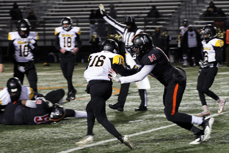Sophomore Deontez Ross defends opposing player at Park's game against DeLeSalle. Their next game will be Oct. 16 at the stadium against Bloomington Jefferson High School.