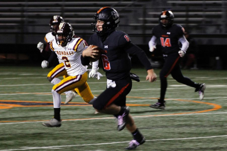 Senior Aaron Ellingson avoids defenders while running the ball down the field. Park finished their season with a loss to Irondale 28-30 Oct. 22.