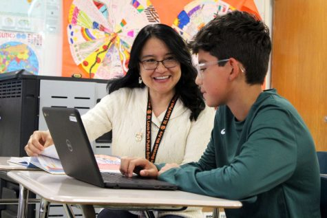 Spanish teacher Nelly Korman assists freshman Solin Mendes-Duffy with an assignment Oct. 24. Korman is running for Bloomington school board for the 2019 election.