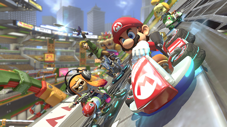 Fair use from Nintendo. Mario speeds past his opponents in his go-cart.