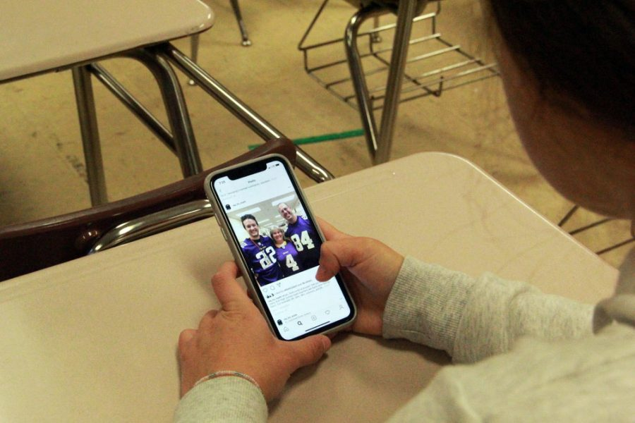 Junior Megan Hoenie browses the new Park math Instagram account. The math department created their Instagram account to highlight events in the math community.