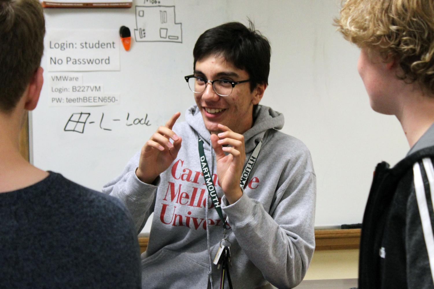 Senior Michael Ramirez discusses strategy for Park Tech's next project during a meeting after school Oct. 2. Ramirez specializes in software and digital aspects of the club.