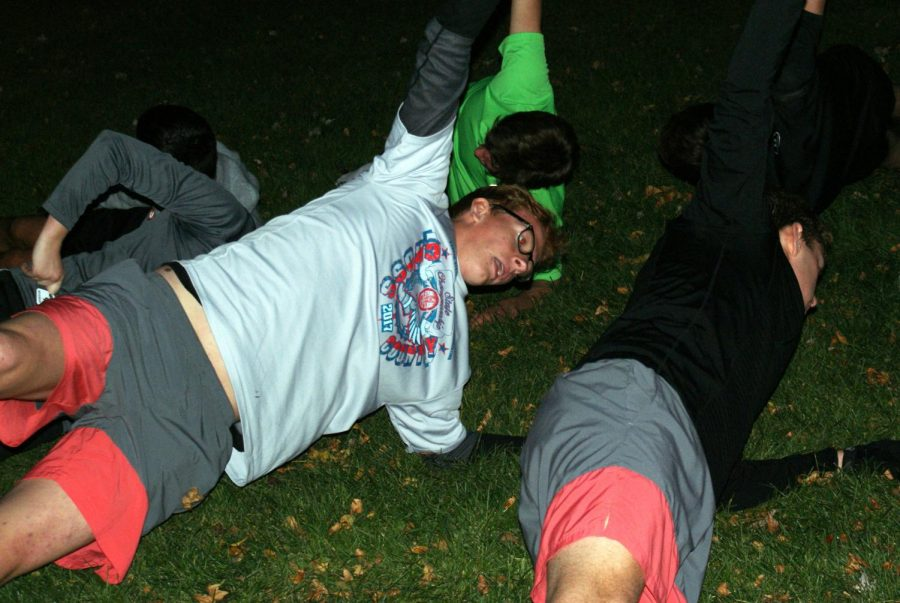 Senior Patrick Djerf completes core exercises during captains practice Oct. 20. Captains practice was held at Dakota Park.