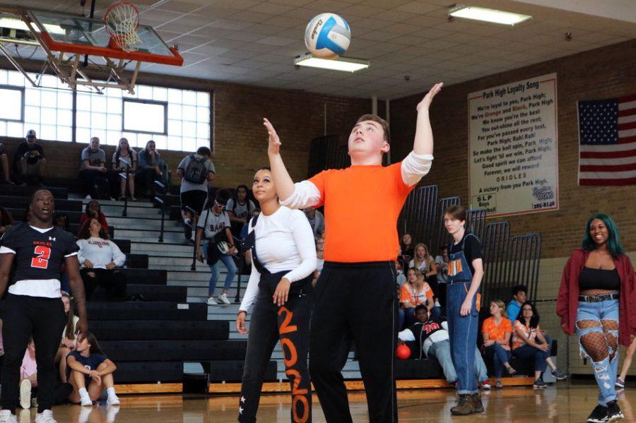 Senior Ryan Erickson serves the ball at the teacher versus Homecoming court volleyball game. The game took place at the Homecoming Pep fest.